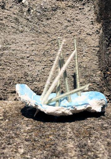 plaster pierced w sticks